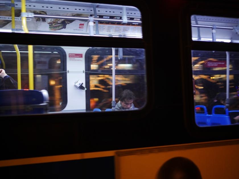 other man sleeping on bus